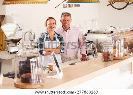 Happy cafe staff - stock photo