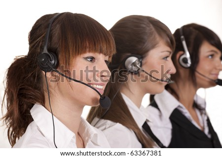 Happy call center employees with headset - stock photo