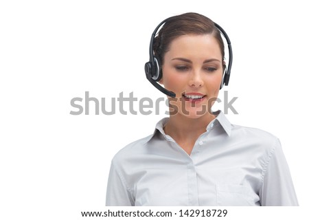 Happy call centre agent wearing headset on a white background - stock photo