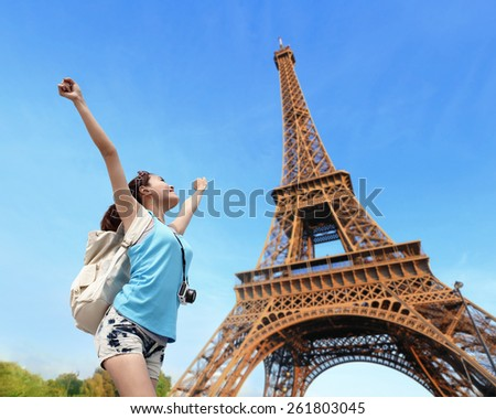 Happy carefree travel woman in Paris with Eiffel Tower, asian beauty - stock photo