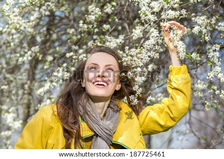 Happy carefree woman enjoy the freshness of the new spring day. copy space - stock photo
