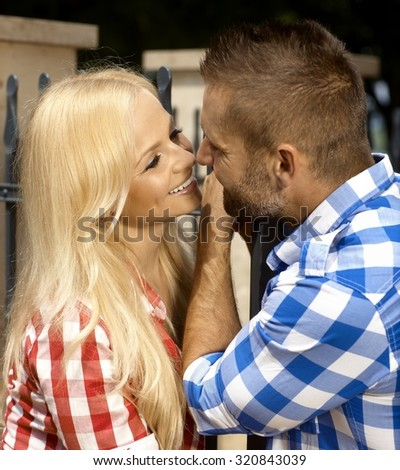 Happy casual blonde caucasian lady with boyfriend outdoor, smiling. - stock photo