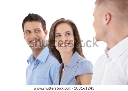 Happy casual businesspeople laughing at colleague, isolated on white. - stock photo