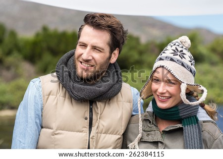 Happy casual couple at a lake in the countryside