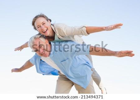 Happy casual couple having fun on a sunny day - stock photo