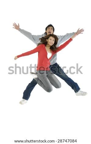 happy casual couple jumping of joy - stock photo