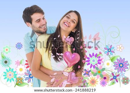 Happy casual couple smiling and hugging against digitally generated girly floral design - stock photo