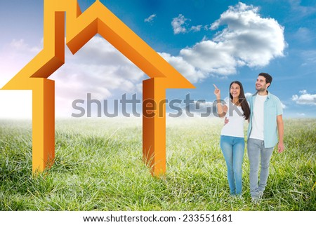 Happy casual couple walking together against sunny landscape