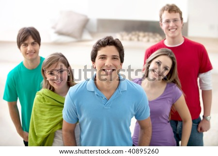 Happy casual group of friends smiling indoors