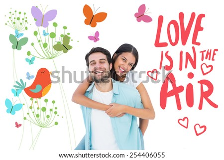 Happy casual man giving pretty girlfriend piggy back against orange bird with heart and dandelions - stock photo