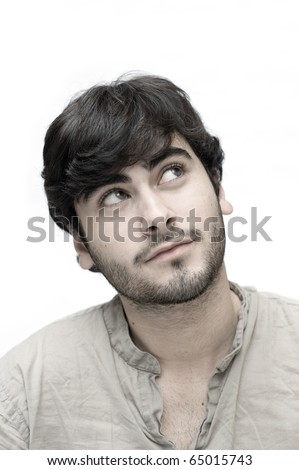 Happy casual man looking up over white background. - stock photo