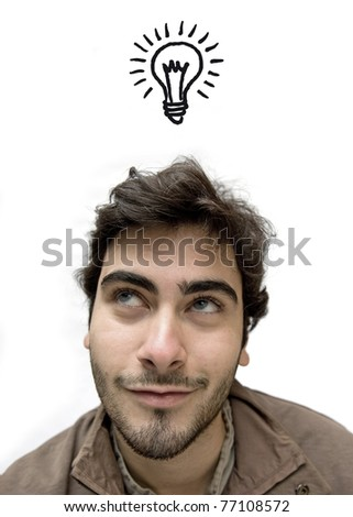 Happy casual man looking up over white background having an idea. - stock photo
