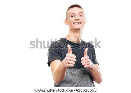 Happy casual man showing thumbs up isolated on a white background - stock photo