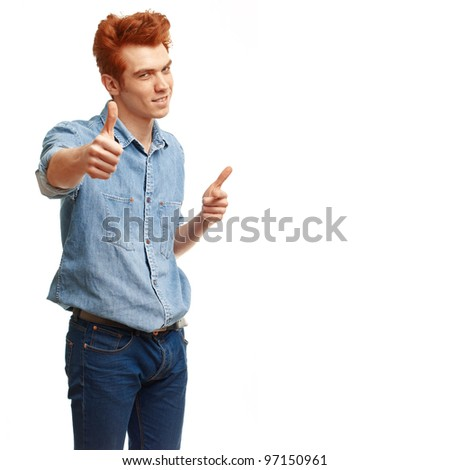 Happy casual red haired young man showing thumb up and smiling isolated on white background. - stock photo