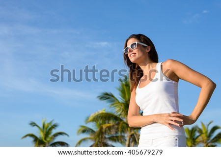 Happy casual woman on tropical vacation looking to the side. - stock photo