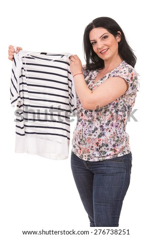 Happy casual woman showing striped t-shirt white with black isolated on white background