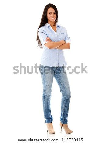 Happy casual woman standing - isolated over a white background - stock photo