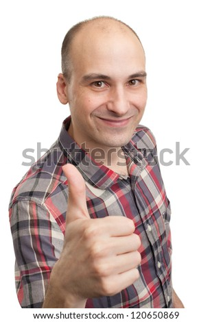 Happy casual young man showing thumb up and smiling isolated on white background - stock photo