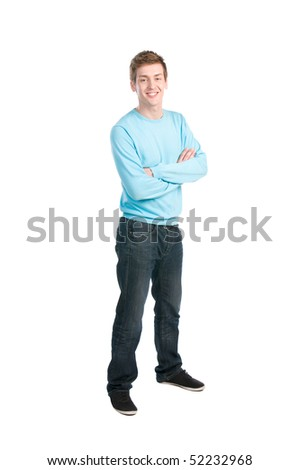 Happy casual young man standing with arm crossed over white background - stock photo