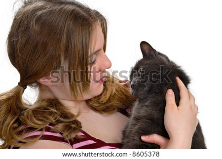Happy cat being held by girl - stock photo