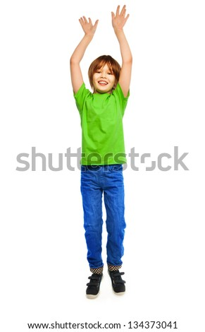 Happy Caucasian boy in green shirt jumping, full height portrait, isolated on white - stock photo