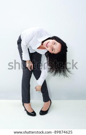 Happy caucasian businesswoman celebrating her victory - stock photo