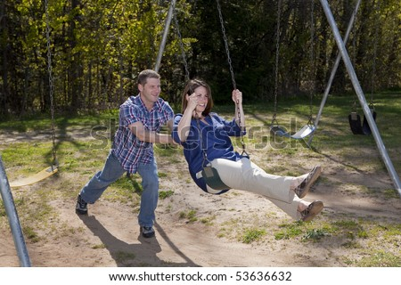 Happy Caucasian couple enjoys a beautiful day at the park - stock photo