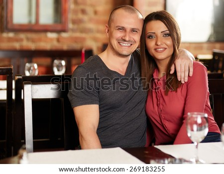 Happy caucasian couple in a restaurant, having a good time - stock photo