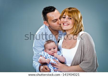 Happy Caucasian Family in th Studio - stock photo
