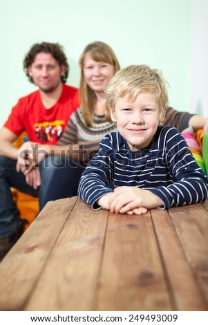 Happy Caucasian family portrait with smiling son - stock photo