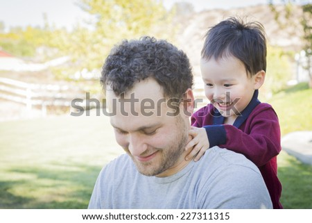 Happy Caucasian Father Having Fun with His Mixed Race Baby Son. - stock photo