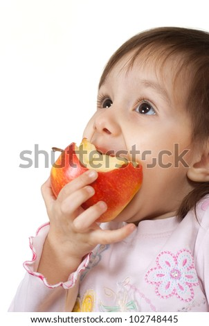 Happy Caucasian girl with an apple on a white background