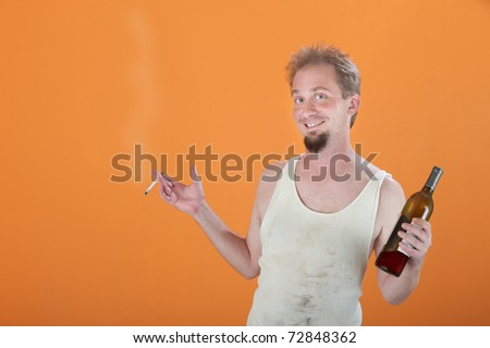 Happy Caucasian man holding a bottle and a cigarette
