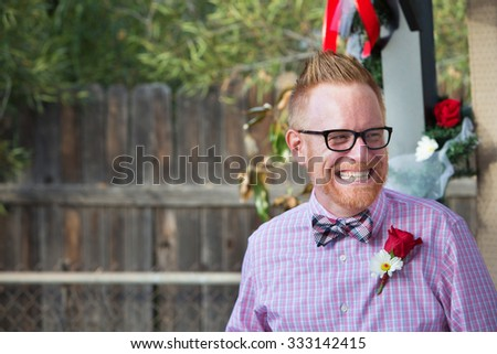 Happy Caucasian man with rose on lapel - stock photo