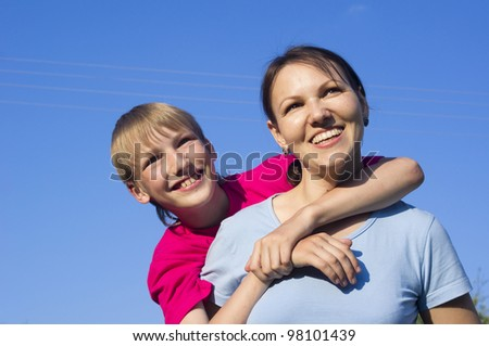 Happy Caucasian mother with her son on the street
