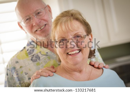 Happy Caucasian Senior Couple Portrait Inside Kitchen. - stock photo