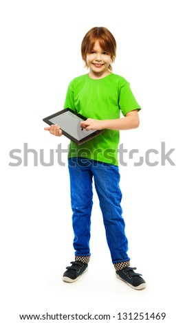 Happy Caucasian 9 years old boy in green shirt with digital tablet computer, full height portrait, isolated on white - stock photo