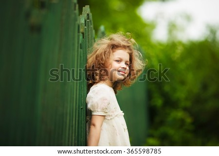 Happy, cheerful and shaggy little girl in a dress - stock photo