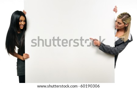 Happy, cheerful business girls hold a presentation board - stock photo