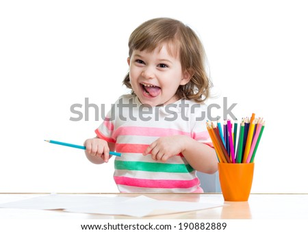 Happy cheerful child drawing with pencils - stock photo