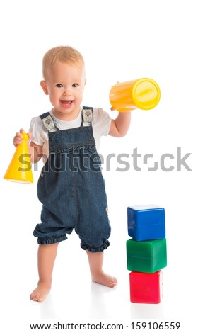happy cheerful child playing with blocks cubes isolated on white background - stock photo