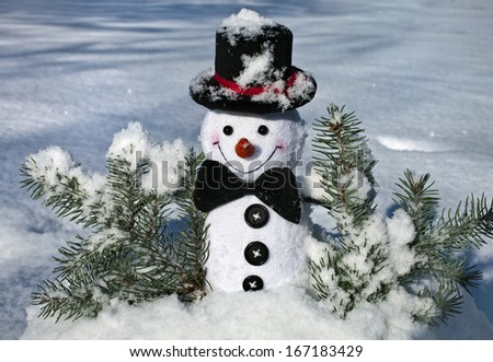 Happy Cheerful Christmas snowman in snow outdoors background - stock photo