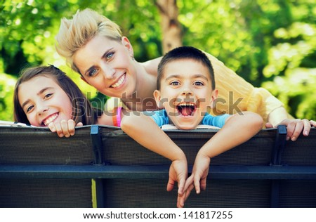 Happy cheerful family - stock photo