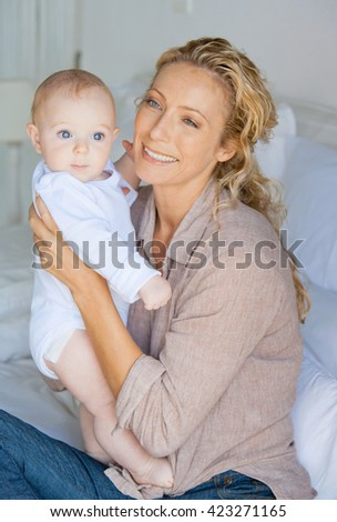 Happy cheerful family. Mother and baby - stock photo