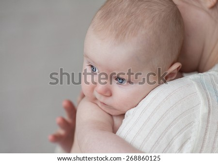 Happy cheerful family. Mother and baby kissing, laughing and hugging - stock photo
