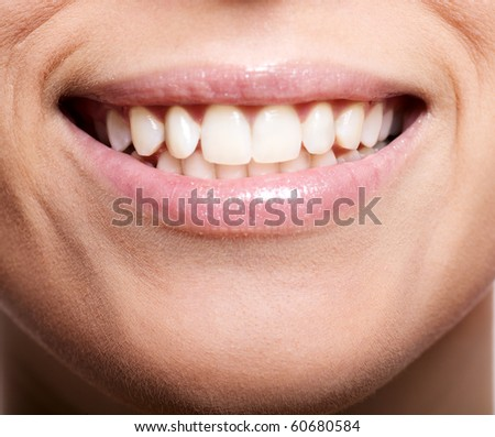 Happy cheerful girl's smile with white teeth isolated on white - stock photo