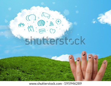 Happy cheerful smiley fingers looking at cloud with blue social icons and smybols - stock photo