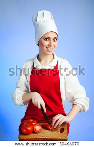 Happy cheerful woman cooking healthy food - stock photo