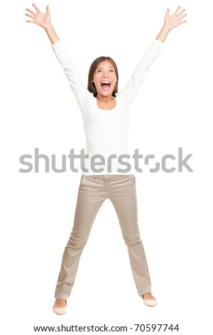 Happy cheerful young woman with arms up joyful. Young energetic and fresh Asian Caucasian model isolated on white background standing in full figure - stock photo
