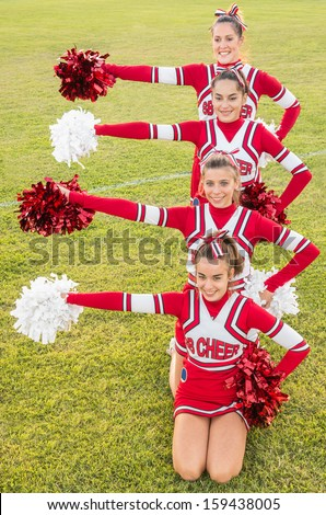 Happy Cheerleaders during Exhibition - stock photo